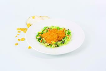 Celery cutlet baked with corn flakes and herb salad