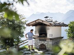Traditional bread baking at the Taser Alpine Hotel